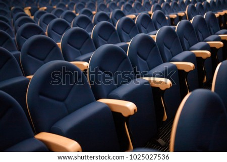 Seats are arranged in row in hall of opera, theater, cinema. Comfortable and soft chairs. #1025027536