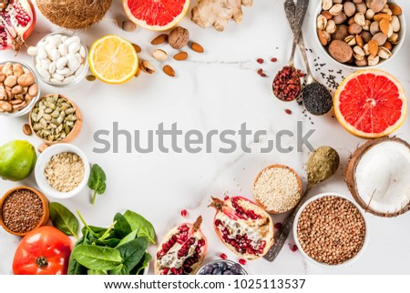 Set of organic healthy diet food, superfoods - beans, legumes, nuts, seeds, greens, fruit and vegetables.. white background copy space. top view frame #1025113537