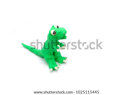 Colorful Play dough (Plasticine) T-rex Tyrannosaurus Rex  or dinosaur mold by boy hands isolated on white background with copy space. Kids toys children's development concept.
