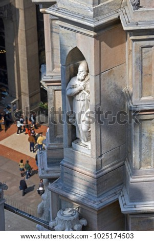 MILAN ITALY - OCTOBER 23RD 2015; Architectural detail of Medieval saint on the Duomo in Milan #1025174503