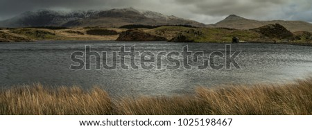 View across the lake to Mount Snowdon and the boathouse at Llyn y Dywarchen in the Snowdonia National Park, Wales. #1025198467