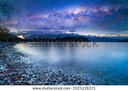 Lake with milkyway background. #1025228371