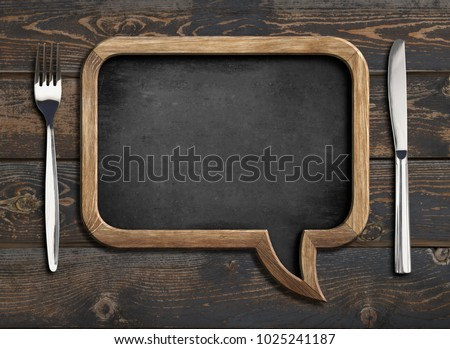 menu blackboard frame on wooden dinning table #1025241187