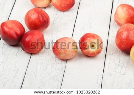 Ripe red peaches on the white wooden table, soft focus background #1025320282