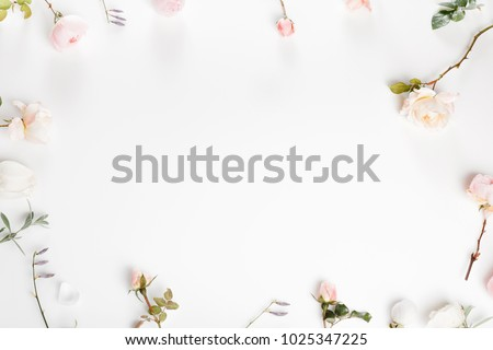 Festive flower English rose composition on the white background. Overhead top view, flat lay. Copy space. Birthday, Mother's, Valentines, Women's, Wedding Day concept. #1025347225