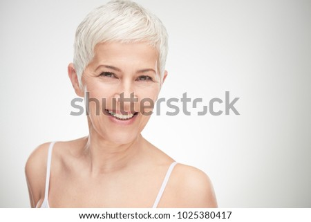 Portrait of beautiful senior woman in front of white background. #1025380417