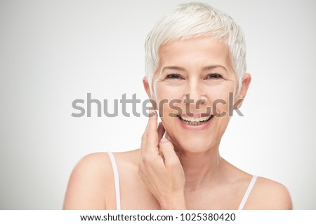 Portrait of beautiful senior woman in front of white background. #1025380420