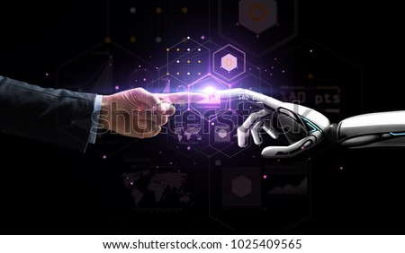 artificial intelligence, future technology and business concept - robot and human hand with flash light and virtual screen projection over black background #1025409565