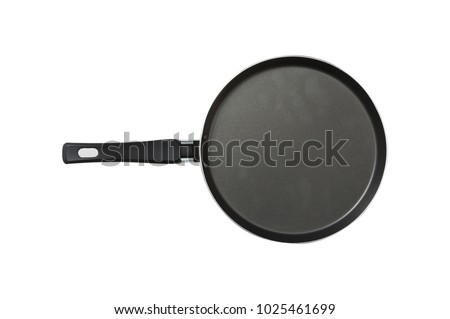 Pan. The black. Kitchen accessories. Tools for cooking. A spoon. Isolated on white background. For your design. . #1025461699