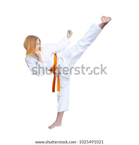 Adult female athlete in karategi is beating blow hand against a white background #1025491021