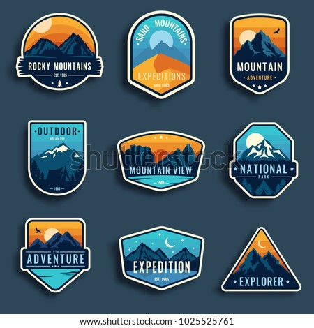 Set of nine mountain travel emblems. Camping outdoor adventure emblems, badges and logo patches. Mountain tourism, hiking. Forest camp labels in vintage style Royalty-Free Stock Photo #1025525761