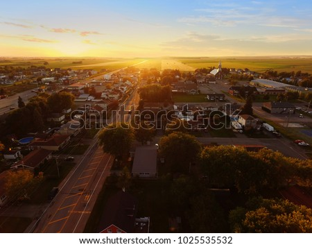 Aerial view of sunset on a small town #1025535532
