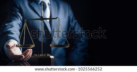Weight scale of justice, lawyer in background. justice law lawyer attorney scale weight court authority concept #1025566252