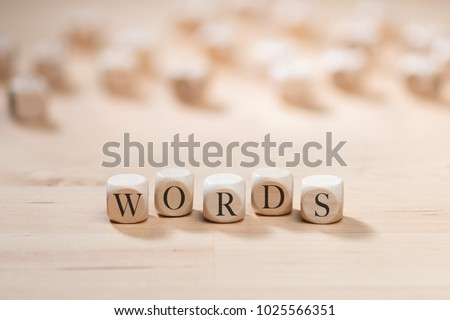 Words word on wooden cubes. Words concept Royalty-Free Stock Photo #1025566351