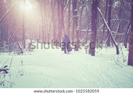 Old man walking on snow covered park #1025582059