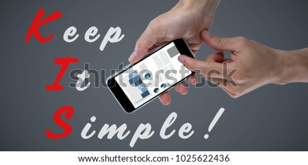 Close-up of cropped hands holding mobile phone against black #1025622436