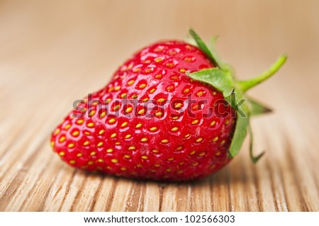 Fresh red strawberries on wooden table #102566303