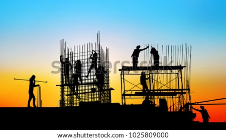 silhouette construction team working on high ground over blurred background sunset sky. #1025809000
