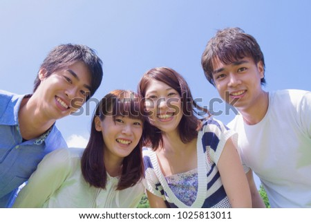 Young japanese people who smile in the park #1025813011
