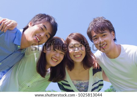 Young japanese people who smile in the park #1025813044