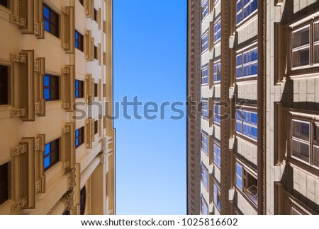 Classical building facades under blue sky, narrow street of Vienna, Austria. Architectural background photo #1025816602