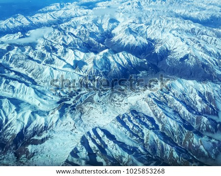 Aerial view on snowy mountain above Georgia  #1025853268
