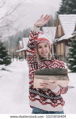 woman holding firewood outdoor #1025858404