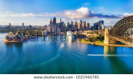 Major architecture landmarks of the city of Sydney and Australia around Sydney harbour in elevated aerial view in warm smooth sunlight at the morning. Royalty-Free Stock Photo #1025960785