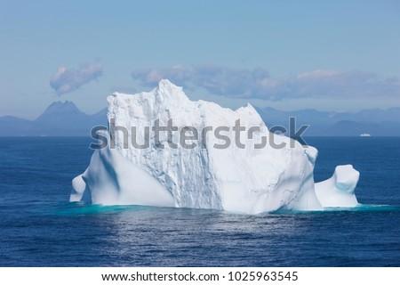 Single iceberg. Greenland coast iceberg floating #1025963545