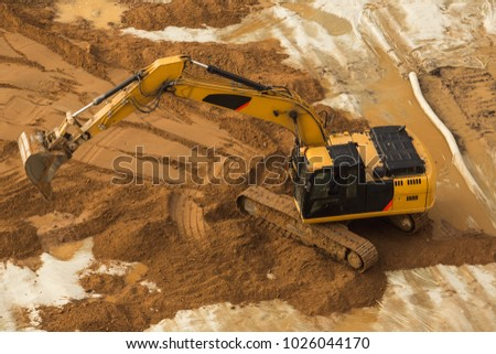 View from above at Working Excavator Tractor Digging A Trench. #1026044170