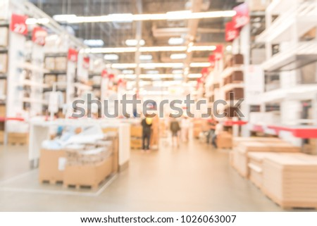 Abstract blur customer shopping in large furniture warehouse in America. Defocused industrial storehouse interior full of boxes, row of aisles, bins, shelves from floor to ceiling #1026063007