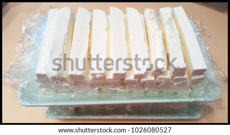 sliced cream cheese and stack on the platter #1026080527