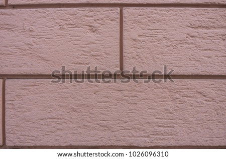 Colored stone blocks of a house wall. #1026096310