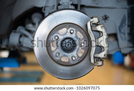Brake system of car. Dise brake and caliper brake and dise pad on vehicle. Royalty-Free Stock Photo #1026097075