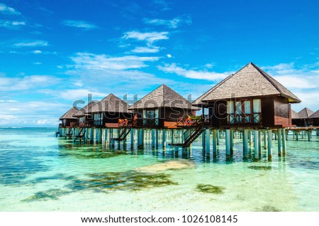 Exotic wooden houses on the water #1026108145