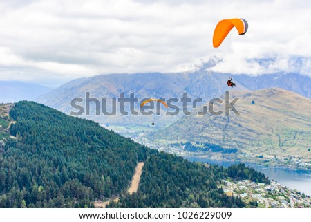 Paragliding at Queenstown, New Zealand #1026229009