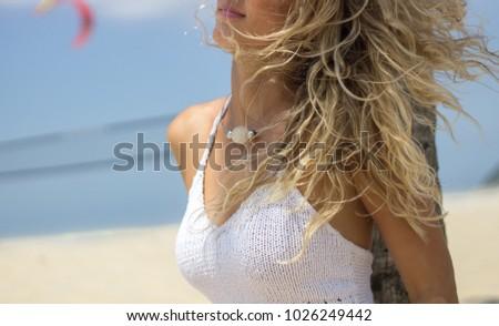 beautiful brazilian tanned on the beach of rio de janeiro wearing jewelry #1026249442