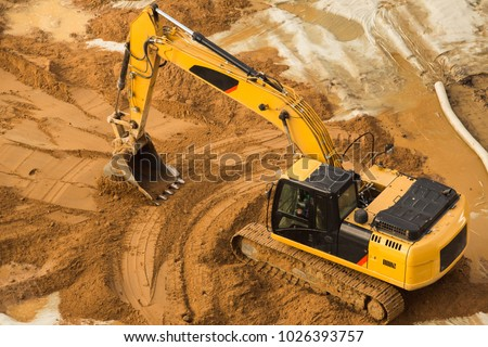 View from above at Working Excavator Tractor Digging A Trench. #1026393757