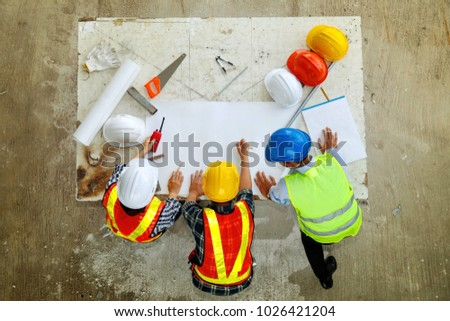 Concept Architects & Teamwork Engineers : Planning meetings, architects and engineers : Top view Fieldwork Three team of architects and engineers working in the construction area. #1026421204