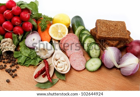Healthy food. Fresh vegetables and fruits on a wooden board. #102644924