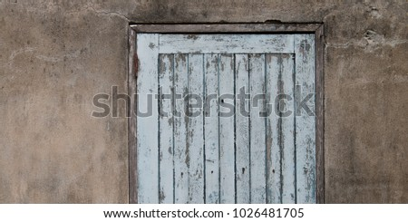 Old wooden plank door with concrete wall #1026481705