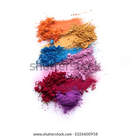 Creative concept photo of cosmetics swatches beauty products eyeshadow on white background.