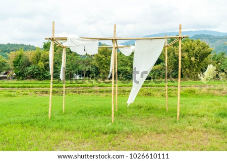 tent with white fabric on field #1026610111