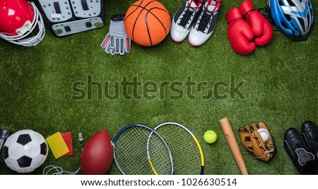 High Angle View Of Various Sport Equipments On Green Grass Royalty-Free Stock Photo #1026630514