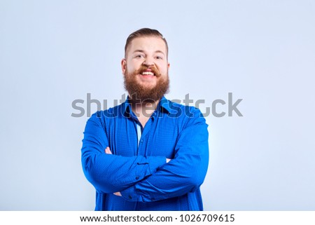 A fat, bearded man with a positive expression of emotion. #1026709615