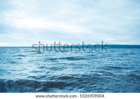 The shore, the blue sea, toned. #1026909004