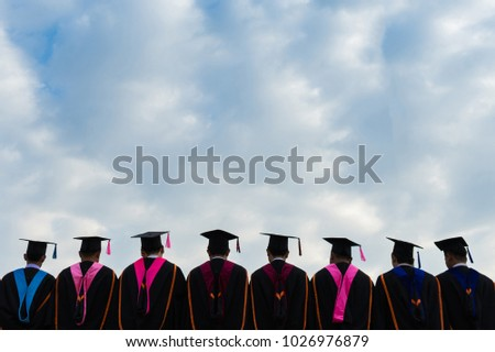 Behind shooting of graduates group photo with clear blue sky in commencement day to receive certificate of degrees. Congratulations to university graduate. #1026976879