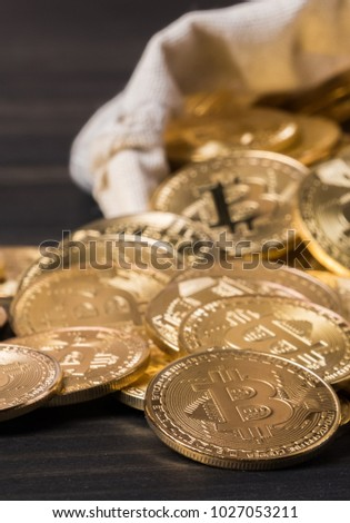 Bitcoin in money pouch on wooden table top #1027053211
