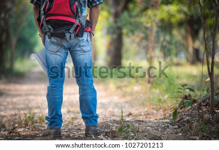 the tourist With backpacks and maps on the road in the woods. #1027201213