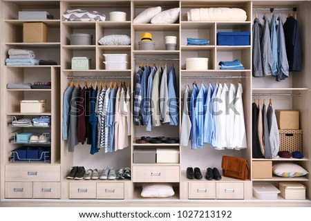 Big wardrobe with male clothes for dressing room #1027213192